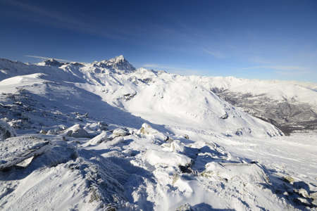 Superb panoramic view of M  Viso  3841 m  mountain range in a winter scenery during a back country ski ascent Stock Photo - 17512357