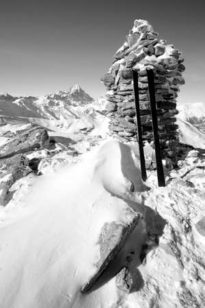 Black and white view of a pair of back country ski on the top of the mountain in a clear bright day and scenic winter background  photo