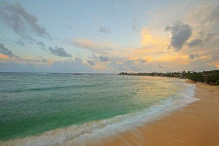 Blurred seascape, long exposure taken on tropical beach during monsoon time at dusk, Unawatuna, Sri Lanka Stock Photo - 17610335