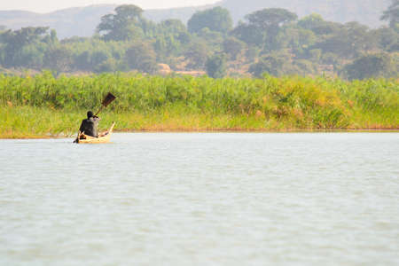primitivism: Getting around in a simple rowboat on Tana Lake in Ethiopia, Africa Stock Photo