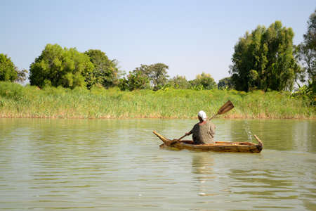 Getting around in a simple rowboat on Tana Lake in Ethiopia, Africa Stock Photo