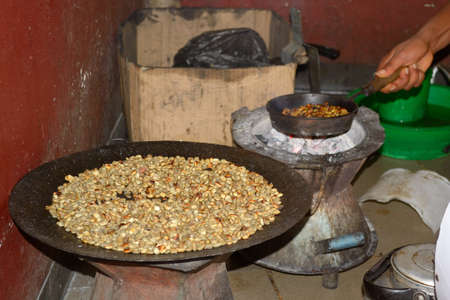 Coffee ceremony in Ethiopia, roasting coffee beans to make coffee in the traditional way