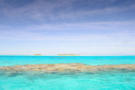 The gorgeous color of Aitutaki lagoon, Cook Islands, taken from boat Stock Photo