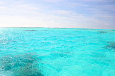 The gorgeous color of Aitutaki lagoon, Cook Islands, taken from boat photo