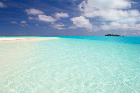The gorgeous color of Aitutaki lagoon and his remote atolls, Cook Islands photo