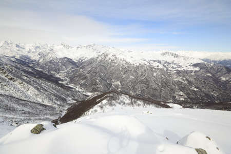 mountainscape: Alpine mountainscape in winter with snowy slope, valleys and clouds