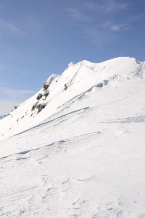 cornice: Snowy slope shaped by the wind with cornice on the ridge  Location  italian Alps