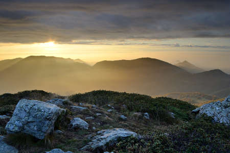 A stunning sunrise view from the summit with dramatic sky and magic mood  Location  western Alps, Torino Province, Italy  photo