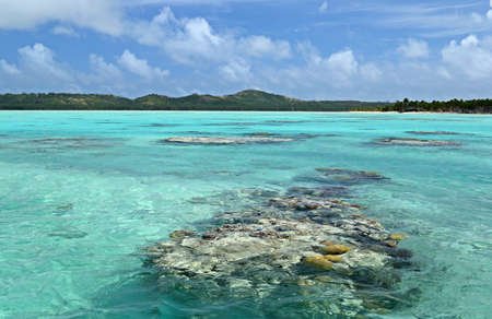desert island: The colorful Aitutaki lagoon spotted by coral reef, in the middle of the South Pacific Ocean  Location  Aitutaki atoll, Cook Islands
