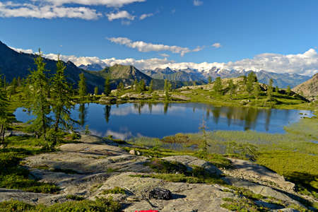 High altitude mountain lake at sunset, in idyllic uncontaminated environment  Location  Italian Alps at 2200 m in Mont Avic Regional Park, Valle d Aosta  스톡 콘텐츠