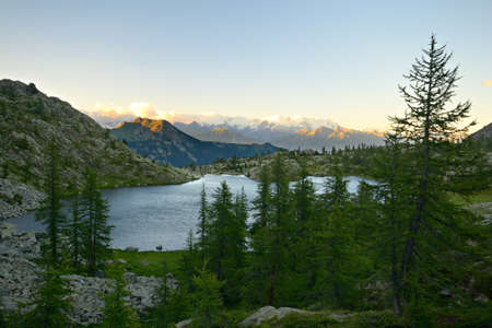 High altitude mountain lake at sunset, in idyllic uncontaminated environment  Location  Italian Alps at 2200 m in Mont Avic Regional Park, Valle d Aosta  photo