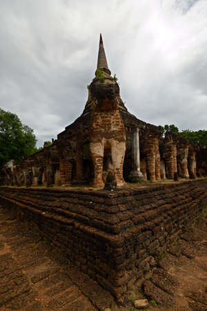 Wat Chang Lom, one of the most remarkable temples in Si Satchanalai Historical Park, ancient temple complex in Sukhothai region, Central Thailand photo