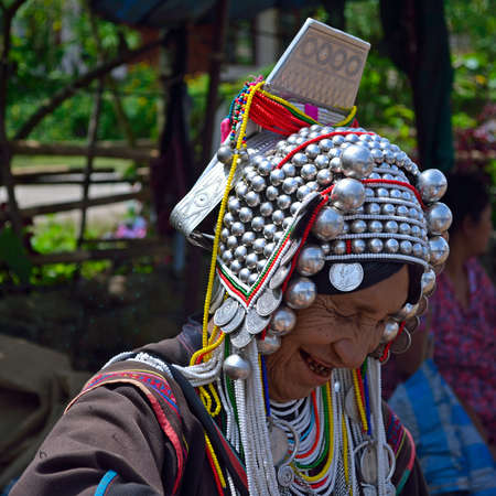Mae Salong, Northern Thailand - August 23, 2013  Akha hill tribe woman in traditional clothing Stock Photo - 22530771