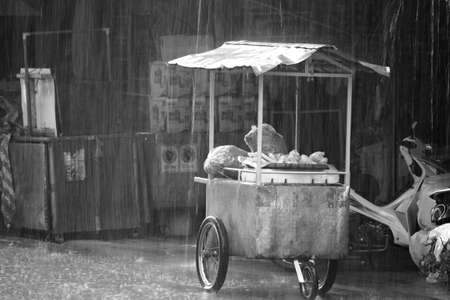 Heavy rain in Mae Sod, Northern Thailand  Motion blur and defocused photo of a market stall
