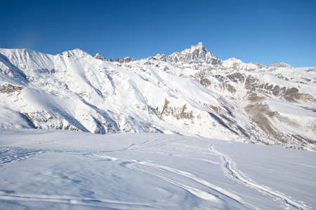 Ski touring tracks  back country ski tracks  in majestic high mountain scenery, italian Alps photo