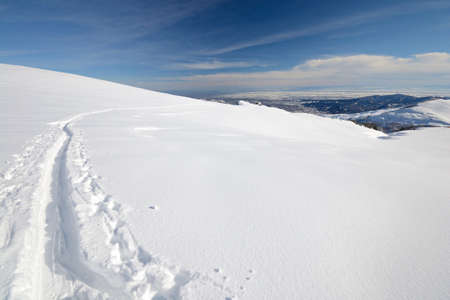 Ski touring  back country skiing  in majestic high mountain scenery, italian Alps photo