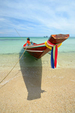 Tourist boat floating on the stunning tropical sea at Ao Haad Khuad, Koh Phangan, Southern Thailand  photo