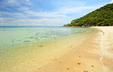 Gorgeous sandy beach with transparent water, coral reef and lush green rainforest at Ao Haad Khuad, Koh Phangan, Southern Thailand  photo