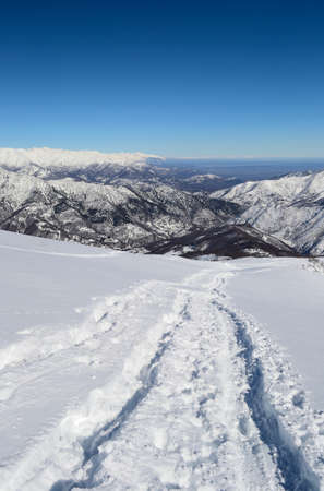 Ski touring tracks leading to the summit in winter scenic landscape. Italian western Alps. photo