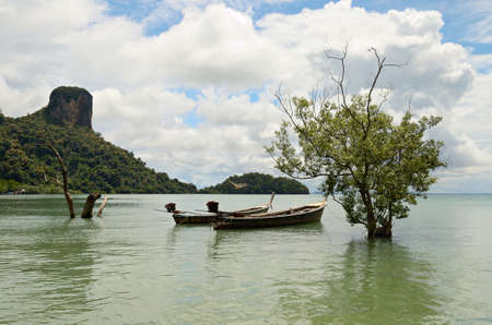 Longtail boat in scenic Railey Bay, Krabi, Southern Thailand  Stock Photo