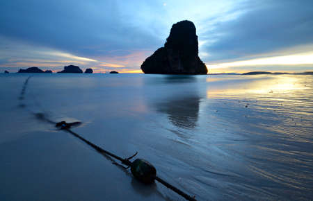 railey: Low tide with a vibrant colored sunset in the majestic scenery of Railey Bay, Krabi, Southern Thailand  Blurred motion, very long exposure