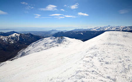 Aerial view from the top of the mountain in wonderful alpine scenery with high mountain range  photo