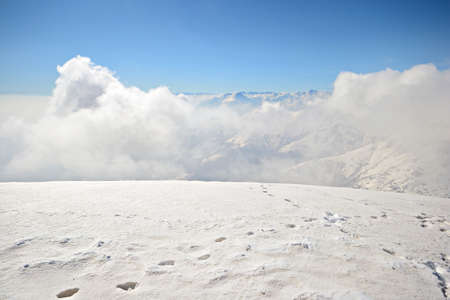 Superb panoramic view from the summit with raising clouds from the valleys below  Italian Alps  photo