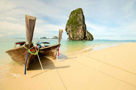 Tourist boats floating on the stunning tropical sea of Railey, Southern Thailand