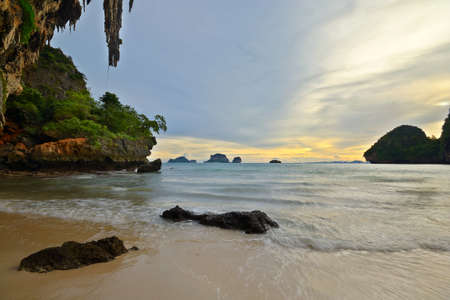 railey: Romantic sunset in the majestic scenery of Railey Bay, Krabi, Southern Thailand  Blurred motion on waves, long exposure  Stock Photo