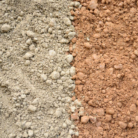 Natural silty soil background, gray and red  photo