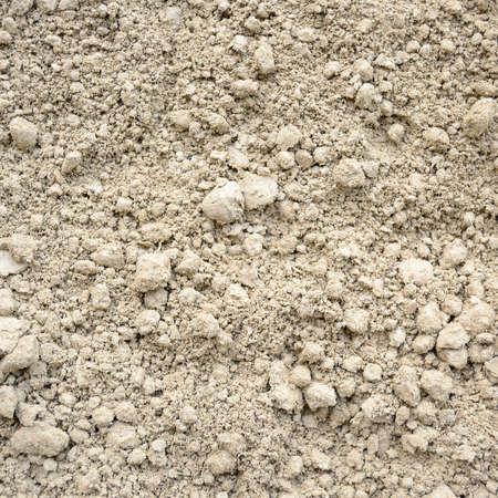 Natuurlijke lemige bodem achtergrond, kleur grijs