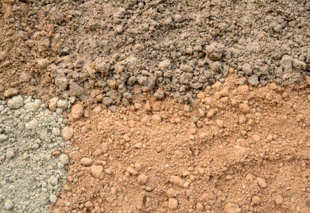 silty: Natural silty soil background  brown, gray and red
