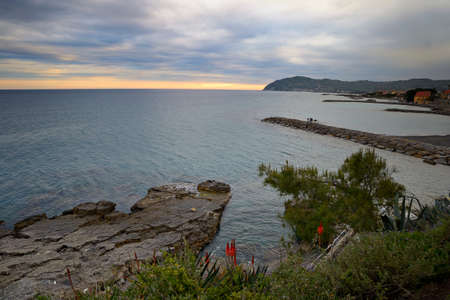 Coastline of San Bartolomeo al Mare at dusk, viewed from above  Blurred motion effect
