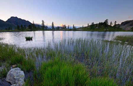 High altitude mountain lake at dusk, in idyllic uncontaminated environment. photo