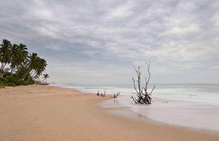 Blurred seascape on tropical desert beach during monsoon time at dusk  Long exposure