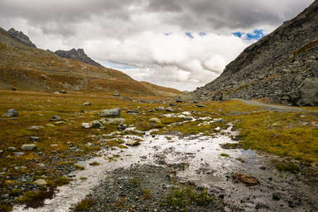 High altitude rocky landscape and little stream, remaining geomorfphology of ancient glaciers. photo