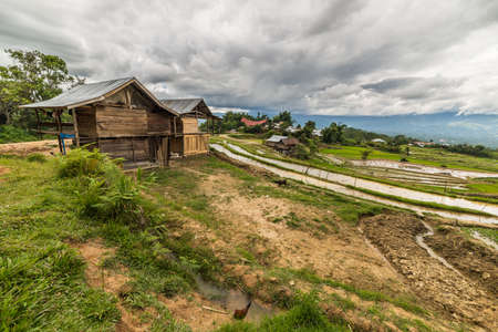 Traditional village with boat shaped roofs in the remote Mamasa Valley, West Tana Toraja, South Sulawesi, Indonesia. photo