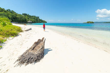 Tourist watching the stunning colors of the remote Togean Islands, Central Sulawesi, Indonesia. Stock Photo