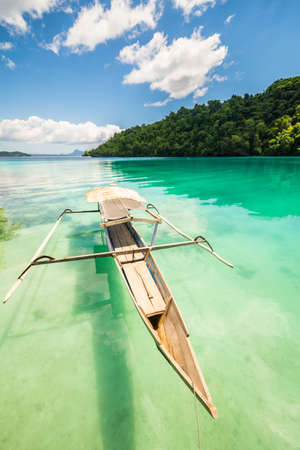 celebes: Traditional boat floating on the transparent sea of the remote Togean (or Togian) Islands, Central Sulawesi, Indonesia. Stock Photo
