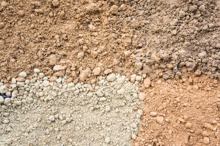 silty: Natural silty soil background: brown, gray and red. Stock Photo