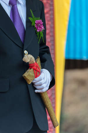 hatchet man: Traditional garments, traditional hatchet in wedding ceremony, Tana Toraja culture, South Sulawesi, Indonesia. Close up. Stock Photo