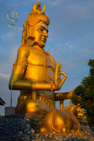 soul searching: Statue of Lord Shiva with his lingam at Koneswaram temple, an important hindu shrine in the Tamil region of Trincomalee, Sri Lanka.