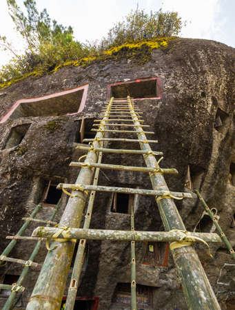 Open Graves In A Cliff With Bamboo Stairs For Access During The.. Stock  Photo, Picture And Royalty Free Image. Image 34782187.