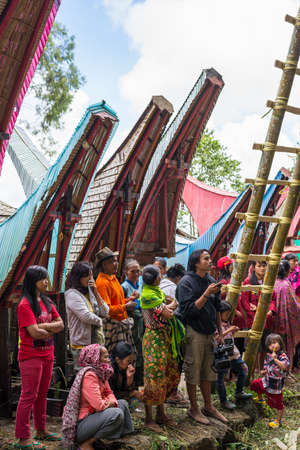 corpses: Lokomata, Indonesia - September 9, 2014: Group of local people attending the ceremony of cleaning corpses (Manene in local language), held once in every 5 or 10 years in Tana Toraja, South Sulawesi.