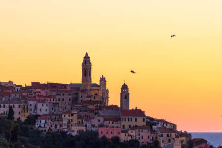 The old town of Cervo, Liguria, Italy, with the beautiful baroque church Arising from the houses. Clear blue sky.