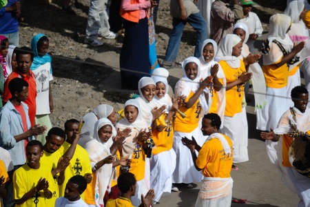 ethiopian ethnicity: Gonder, Ethiopia - January 19, 2012: group of unidentified people dressed in traditional attire during the Timkat holiday, the important Ethiopian Orthodox celebration of Epiphany.