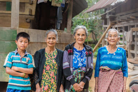 Taupe, Sulawesi, Indonesia - August 16, 2014: Portrait of Toraja senior and young people in the village of Taupe, Mamasa region, West Tana Toraja, Sulawesi, Indonesia.