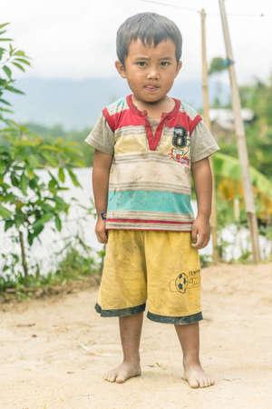Osango, Sulawesi, Indonesia - August 17, 2014: One single child of Toraja ethnicity in the village of Osango, Mamasa region, West Tana Toraja, Sulawesi, Indonesia. Toned image. Editorial