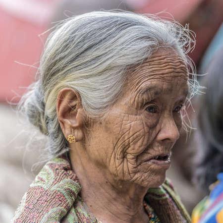 toraja: Lokomata, Sulawesi, Indonesia - September 9, 2014: Portrait of a senior woman of Toraja ethnicity with fun facial expression, in Lokomata, Tana Toraja, Sulawesi, Indonesia.