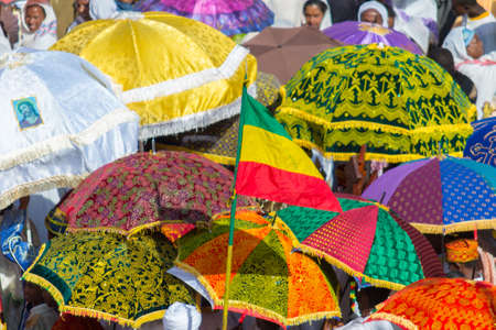 ethiopian ethnicity: Gonder, Ethiopia - January 19, 2012: group of unidentified people under colorful umbrellas during the Timkat holiday, the important Ethiopian Orthodox celebration of Epiphany. Editorial